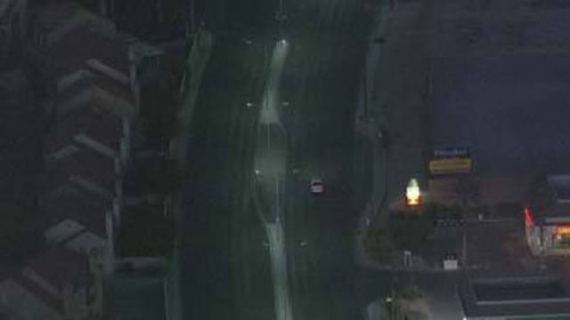 Driving You Crazy: Dark Streetlights Along Sunset Road