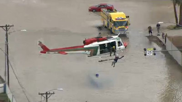 Firefighters Rescue Dozens in Valley Flooding