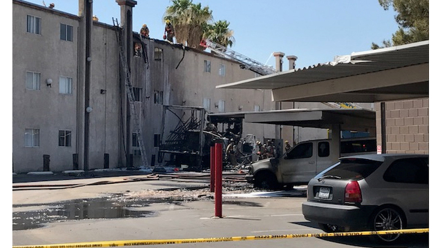 Apartment building fire sends 2 people to the hospital