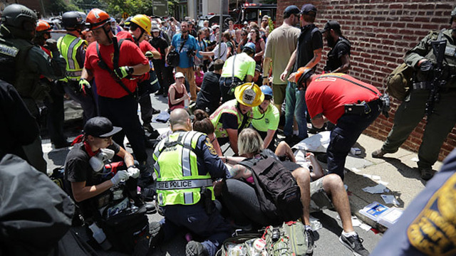 One killed, 19 injured after car plows into protesters