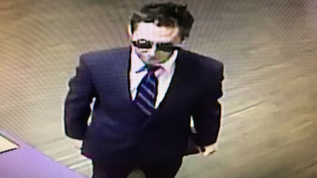 Police search for well-dressed suspect