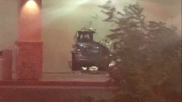 Woman hurt after a car crashes into Burlington Coat Factory