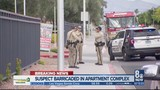 Police investigate barricaded suspect in west Las Vegas
